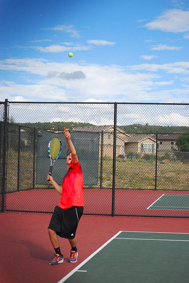 Brennan Stuart, 11, sets up his serve