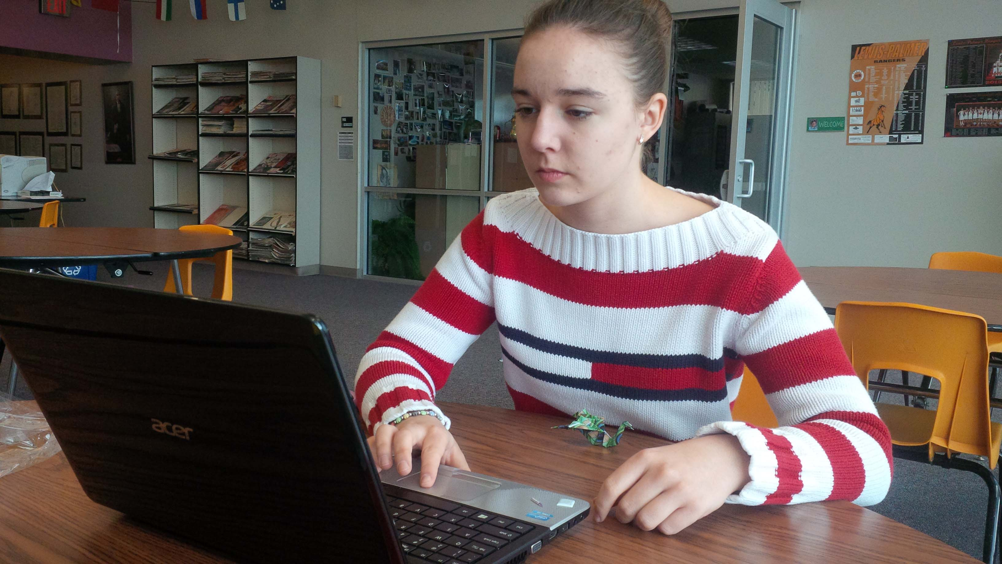 Sofia Kirienko, 12, solemnly checks her inbox in anticipation of an admissions message