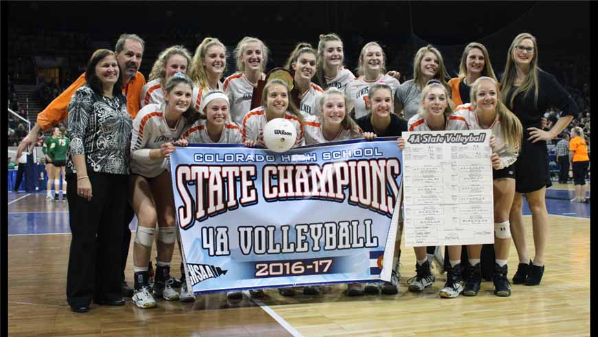 The+LP+Volleyball+Team+smiles+for+the+camera+after+they+won+the+State+Championship.+
