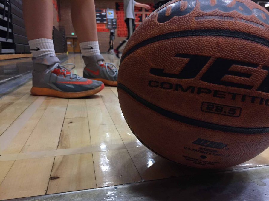 Basketball+player+gets+ready+for+a+basketball+practice+to+prepare+for+upcoming+games.+