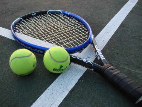 Photo taken by Vladsinger at English Wikipedia. Tennis gear lies in wait on the court.