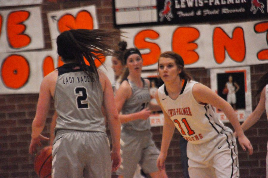 Madison+Farrell%2C+11%2C+defends+her+basket+from+an+Air+Academy+player.+