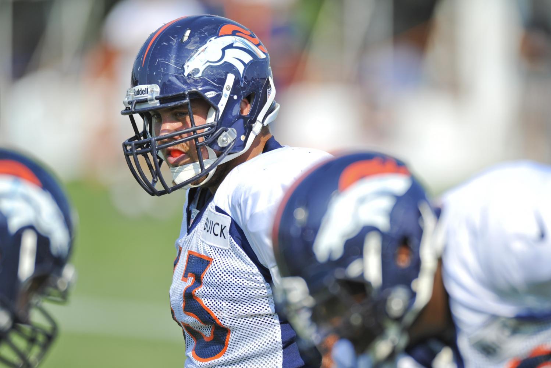 Broncos Quarterback Trevor Siemian preparing to receive the snap