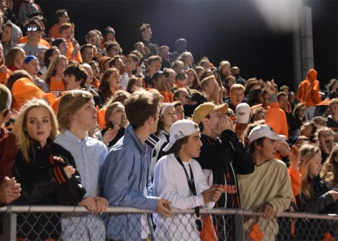 Ranger fans cheer with the Rowdy Rangers at the Homecoming football game.