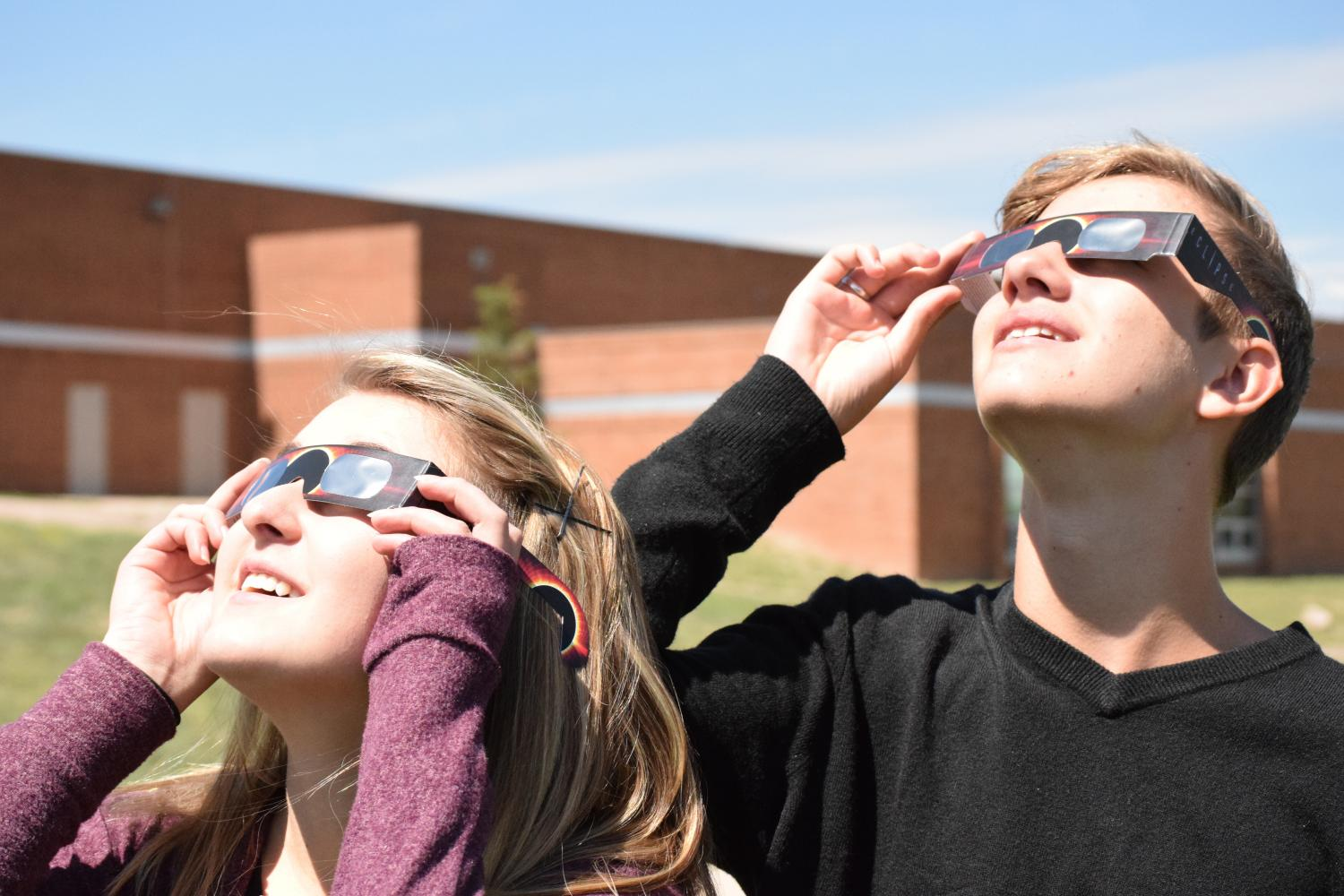 Students+Scott+Reif+and+Isabel+Hebenstreit+marvel+at+the+eclipse+as+it+passes+through+Colorado%27s+highest+point+of+totality+on+Monday+August+21.
