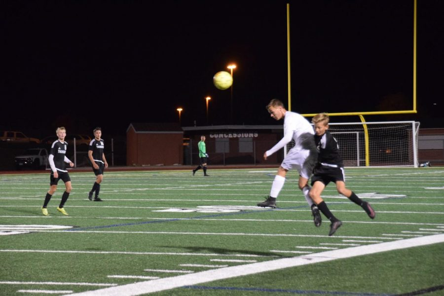 Justin+Dahl+11+kicks+the+soccer+ball+away+from+Discovery+Canyon+player.+
