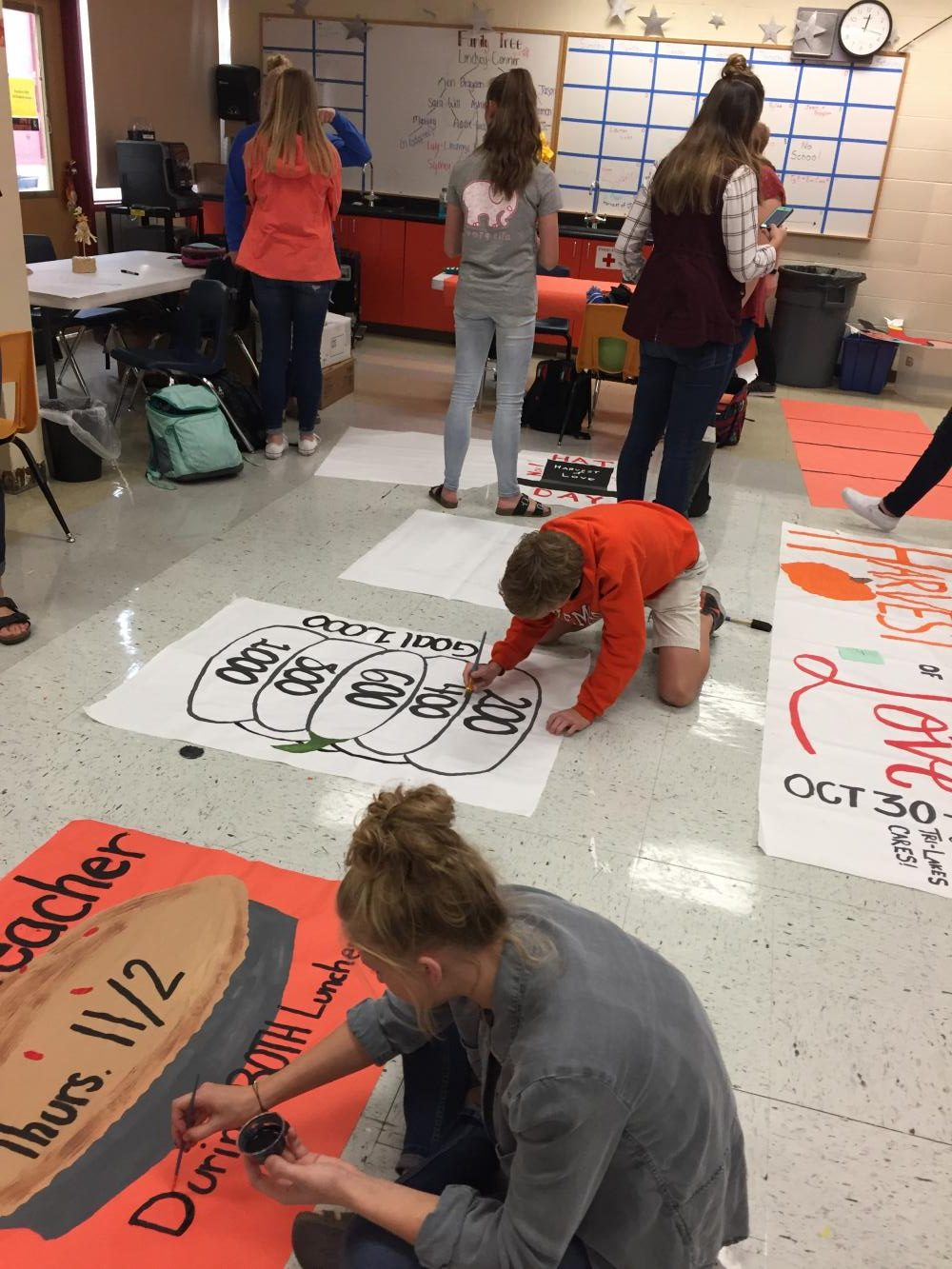 Student Council members design posters for Harvest of Love.