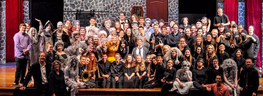 The+cast+of+the+Addams+Family+play%2C+including+Sara+Oliver+11%2C+close+the+performances+with+a+cast+picture.+