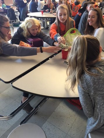 Students donate money during a Miracle Minute.