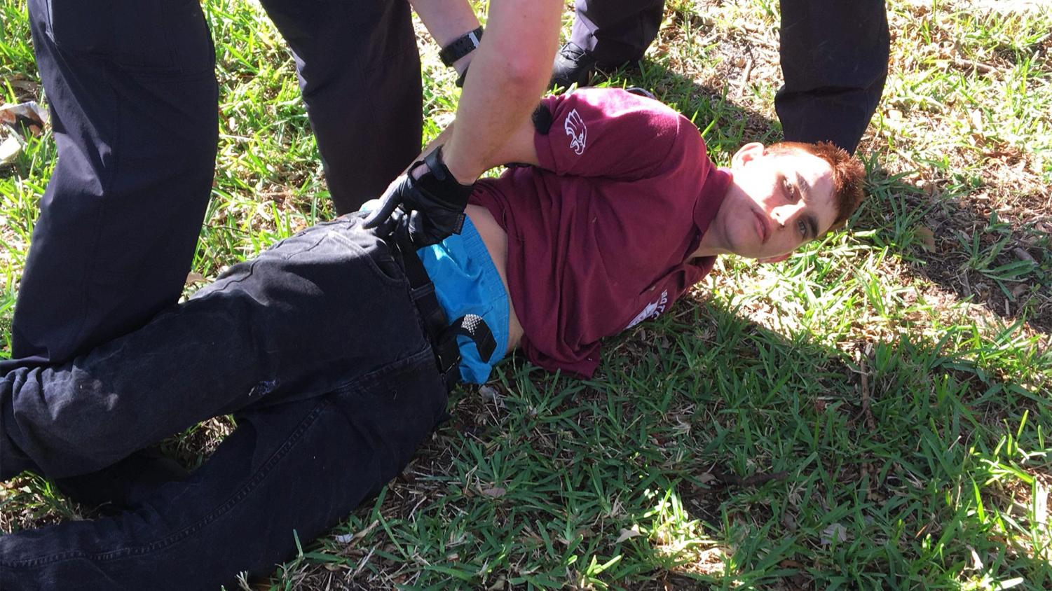 Nikolas Cruz being arrested after police find him walking through a residential area.