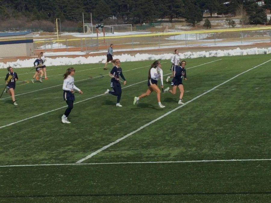 Girls varsity lacrosse scoops up its first win