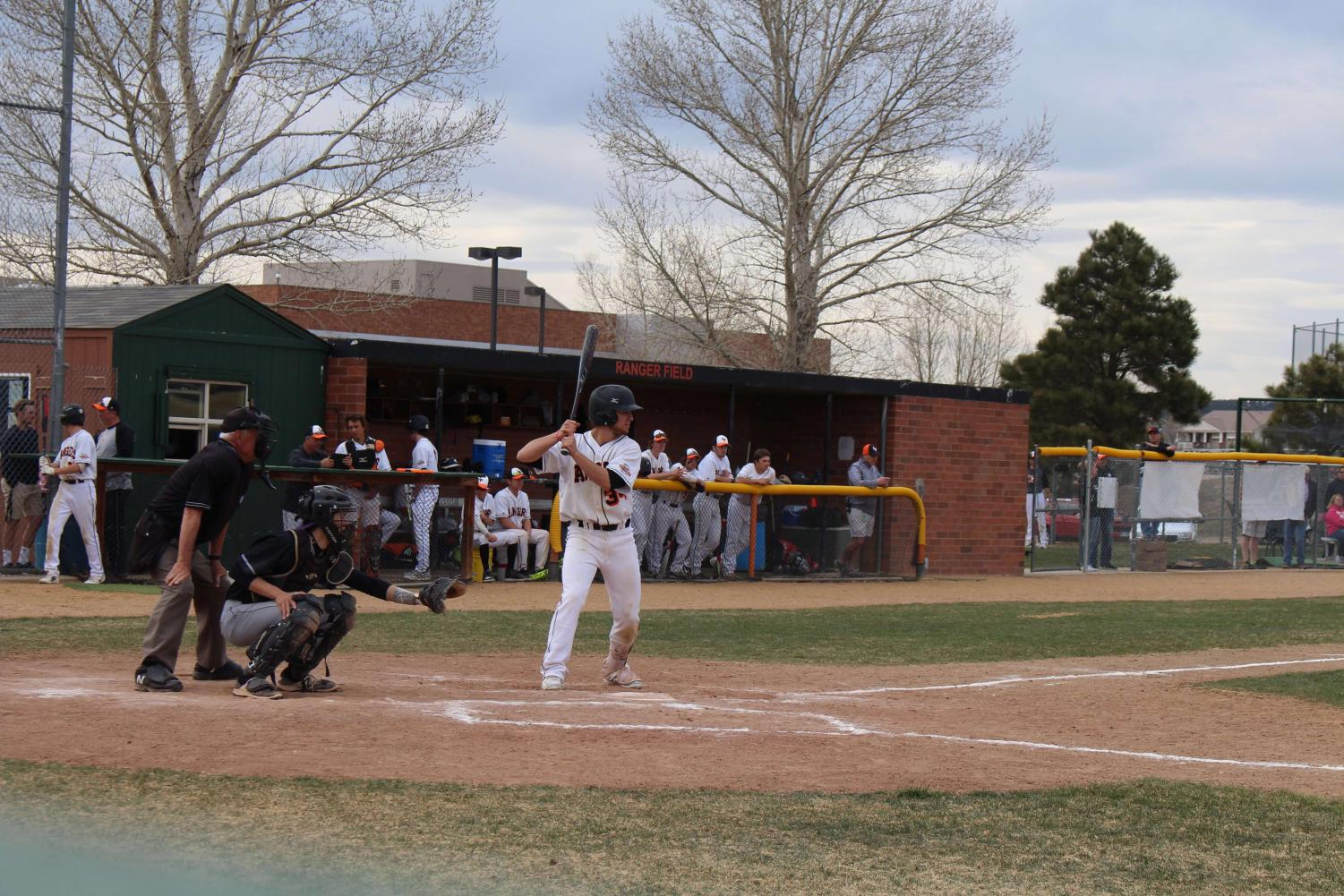 Johnathan Behm is getting ready to hit. He is first in his team's batting line-up.