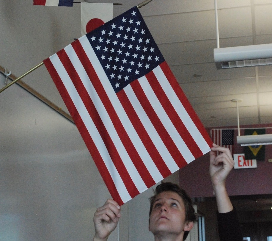 Wirz adjusts the American flag, as it will be his home for the upcoming year.