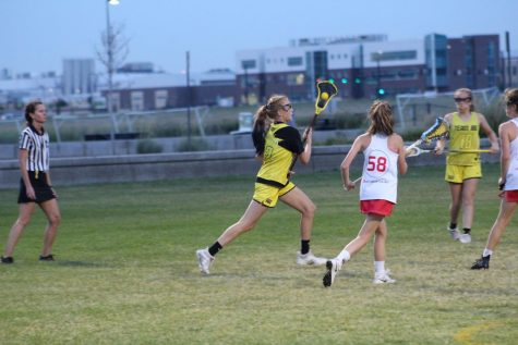 Ryals runs with her lacrosse stick towards the goal line.