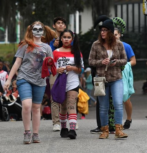 Teenage students (pictured above) dress up and participate in