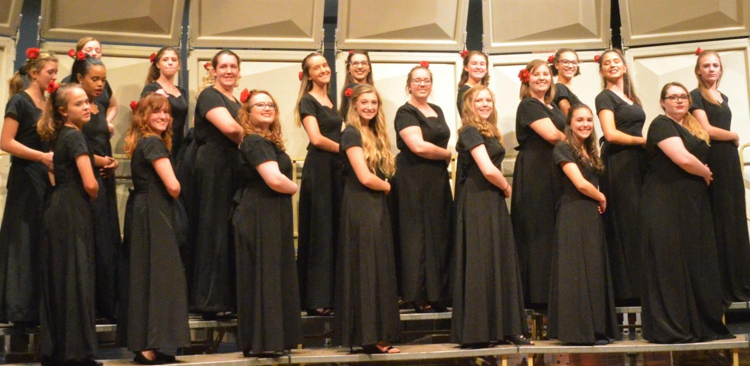 """Treble Voices sings Las Amarillas their last song of the night. """"I have been very happy with both choirs over the past couple of years and I am very proud of all my students,"""" Mr. Douthit said."""