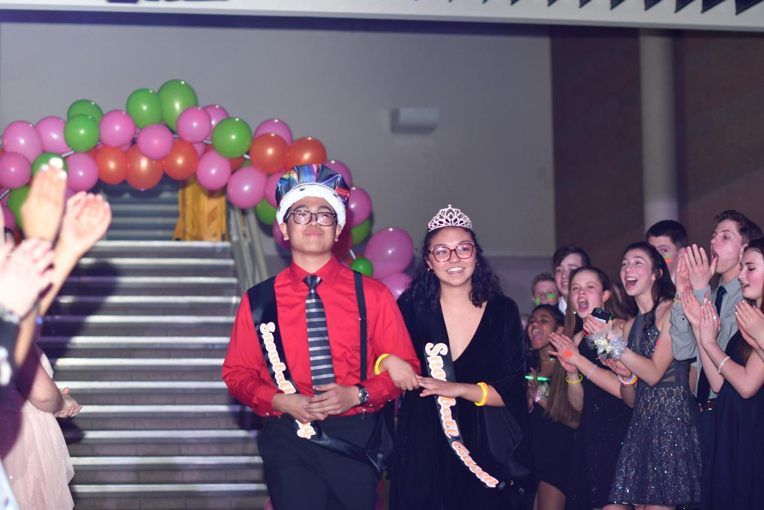 Erika Hartel 12 and Josiah Guerrero 12 accepting their crowns and sashes at the glowball dance after being announced Snowball King and Queen at the school's assembly the day before.