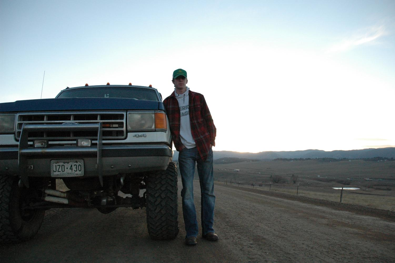 Austin Jones 11 stands beside his truck near County Line Road.