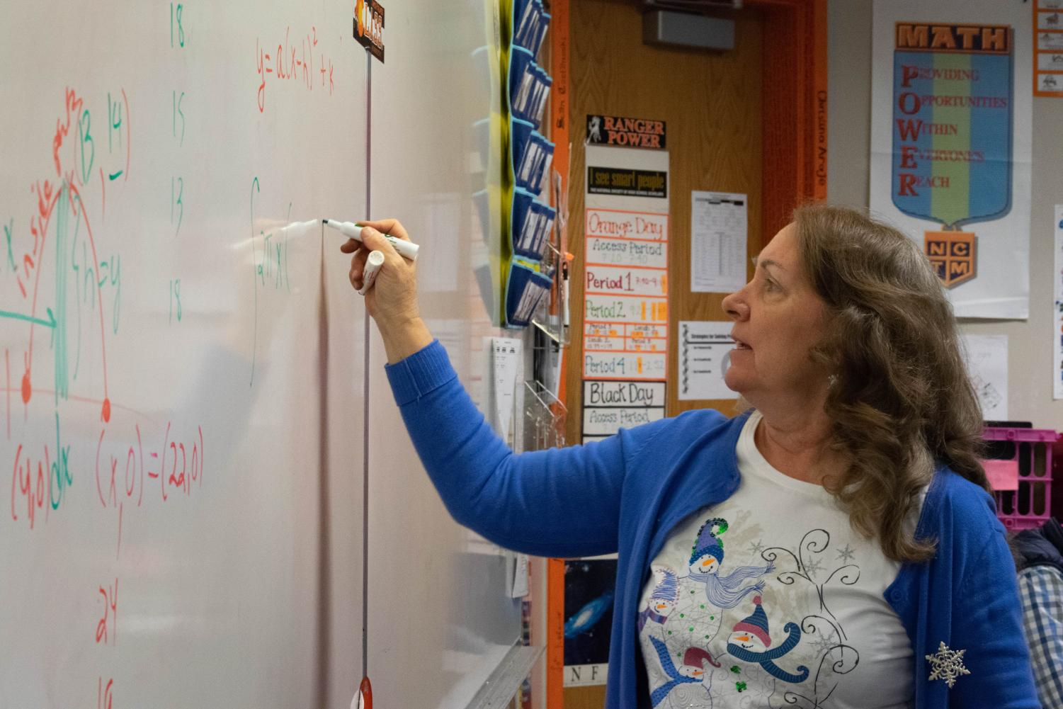 Thirkell explains a homework problem in AP Calculus. Students in her class saw 5 to 20 percent increased performance on their tests after participating in the Emergenetics program.