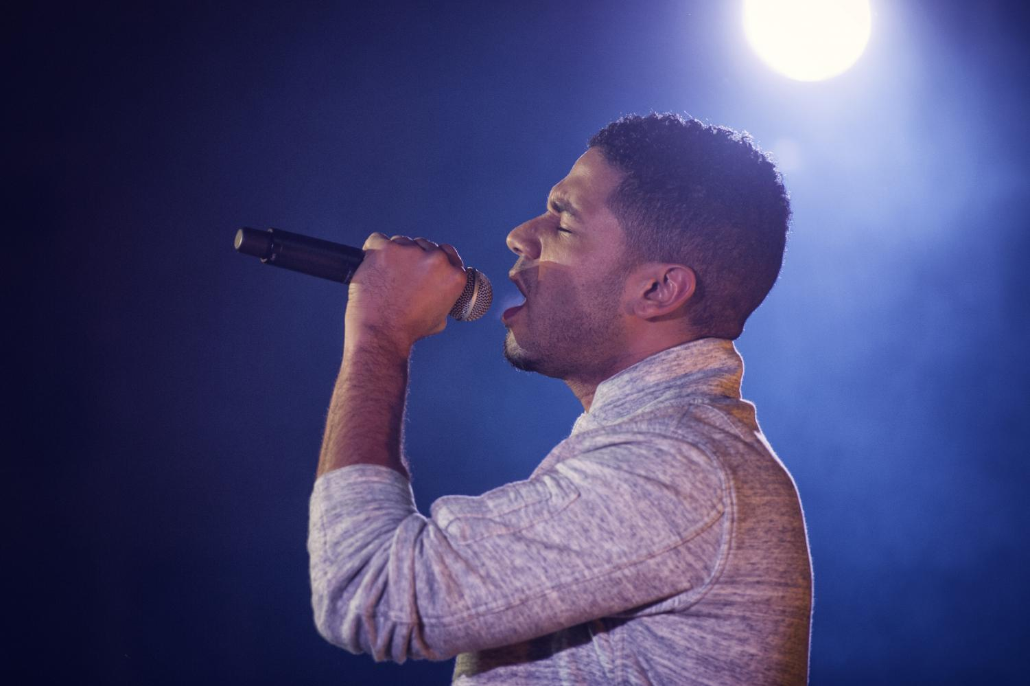 Jussie Smollett sings on stage at Yokota Air Base in Fussa, Japan. According to Empire's director, Smollett makes about $65,000 per episode for the most recent season of the TV series.