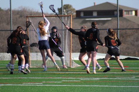 Girls varsity lacrosse team dominates first season game