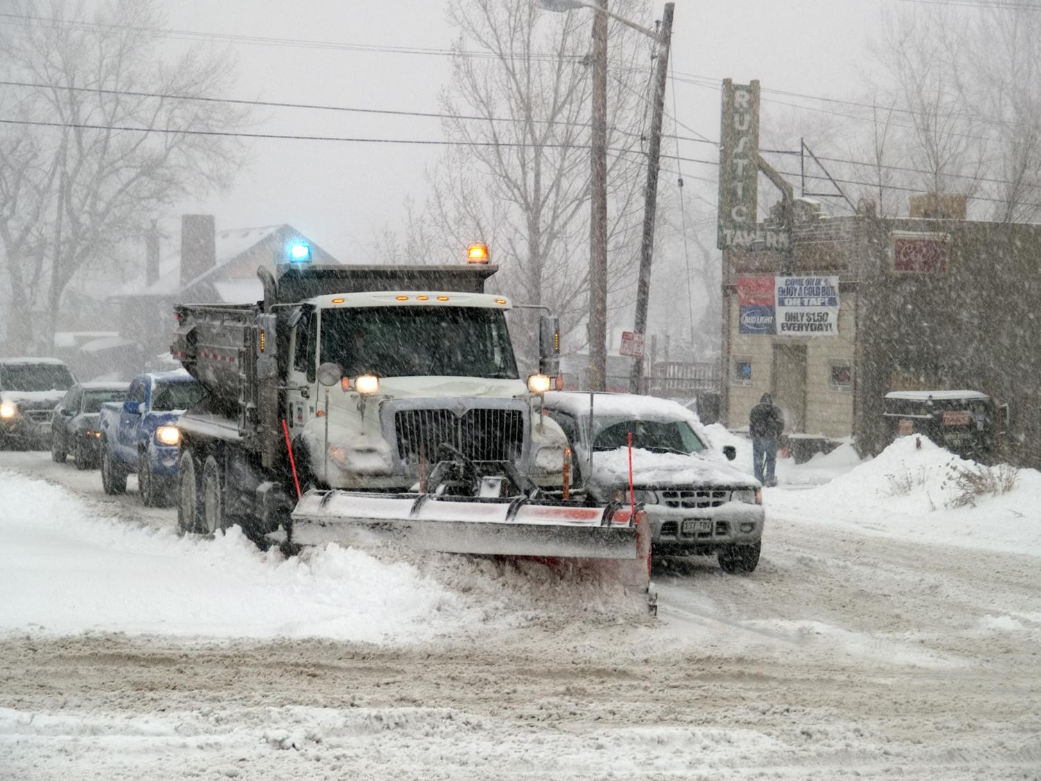 A snow plow clears the road to make it safe and drivable for people. It is important for people to get to work and school, no matter the weather.