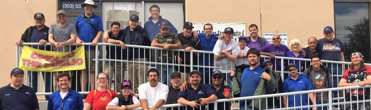 """The recycling staff stands together for a picture. """"They don't burn out, they don't get sick of the work, they don't bring any drama to work. The experience has been nothing but incredible for me,"""" Morris said."""