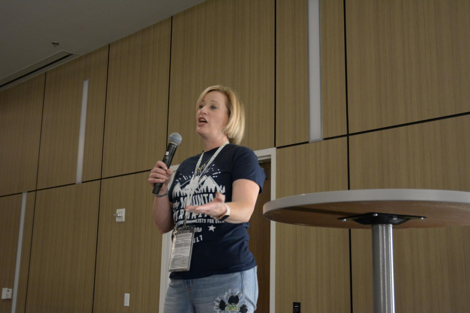Nicole Arduini, director at the Rocky Mountain Camp, delivers a speech at a Key Note presentation.