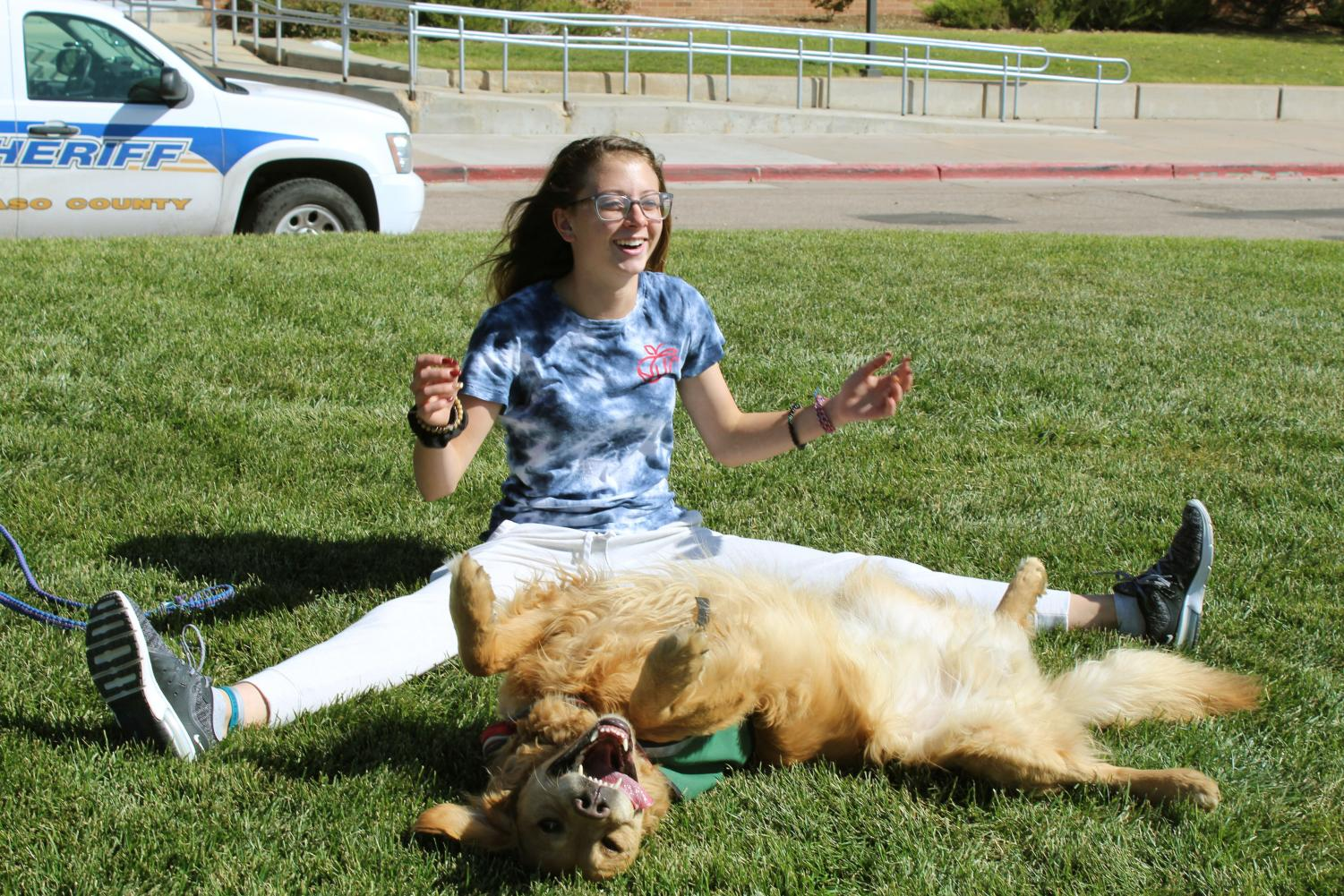 "Smagner shares a smile with her dog, Scout, while taking him outside to release some energy.  ""I knew he was going to be my best friend and my partner, ever since he was a puppy,"" Smagner said."