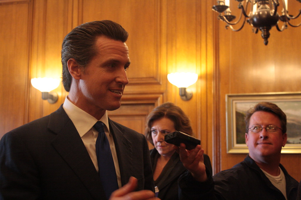 """Gavin Newsom discusses Fair Pay to Play Act. """"Every single student in the university can market their name, image and likeness; they can go and get a YouTube channel, and they can monetize that. The only group that can't are athletes. Why is that?"""" Newsom said."""
