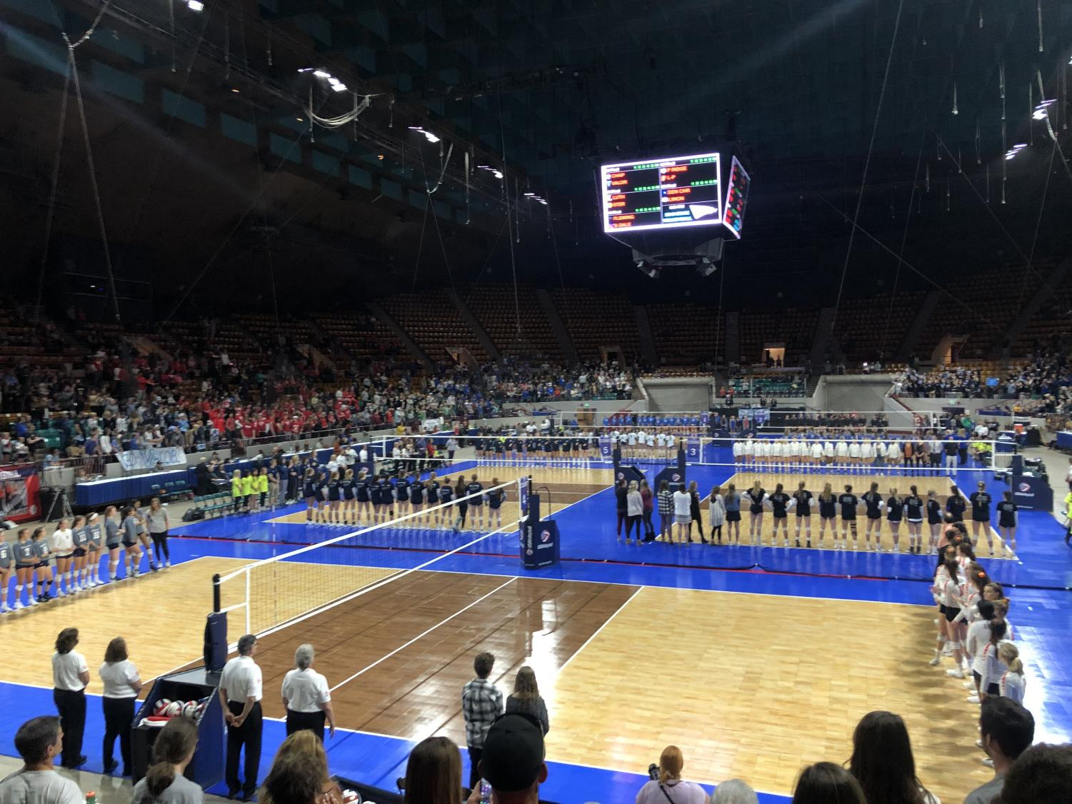"""The volleyball team lining up to announce all the teams that made it to the championship. """"I am so happy the girls beat Palmer-Ridge."""" Hannah Johnson 11 said,"""" Volleyball is are thing and I'm so glad that they one.""""  Photo Credit: Holly Espesito"""