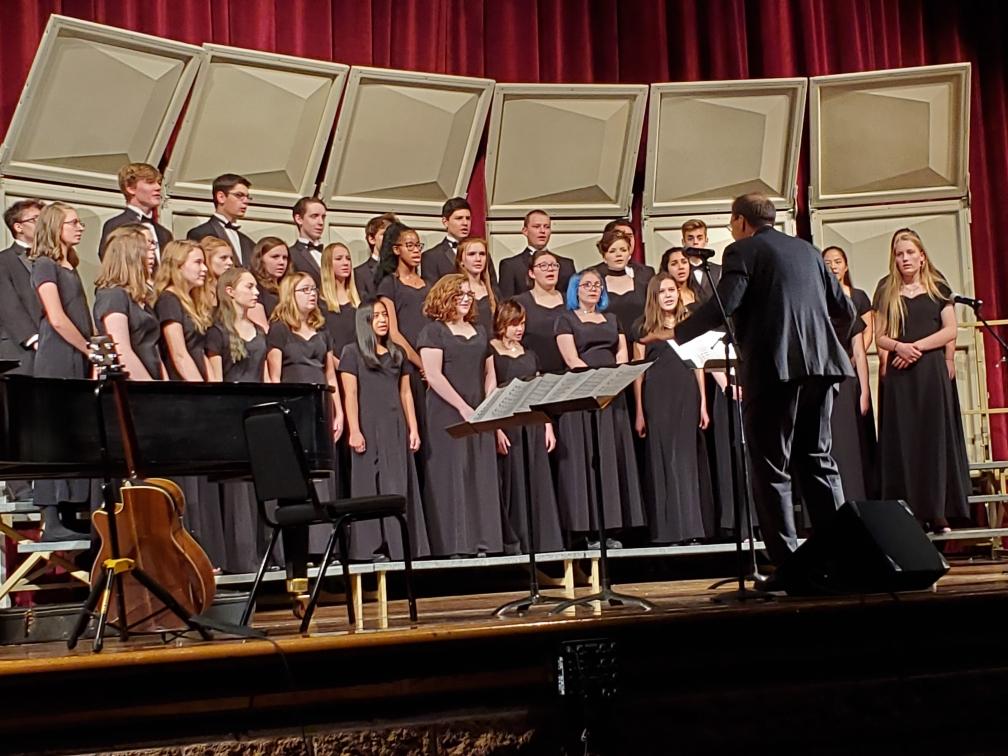 Choir members sing at the rescheduled concert.