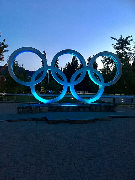 Olympic sign shined in blue light. Five rings like the five new added sports.