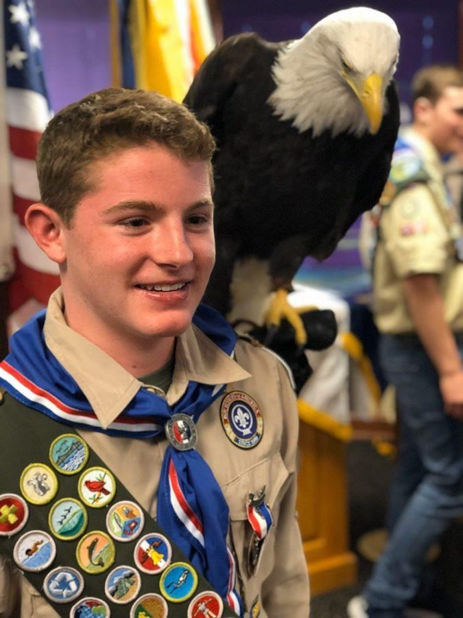 Brandt poses with an eagle at his Eagle Scout Ceremony.