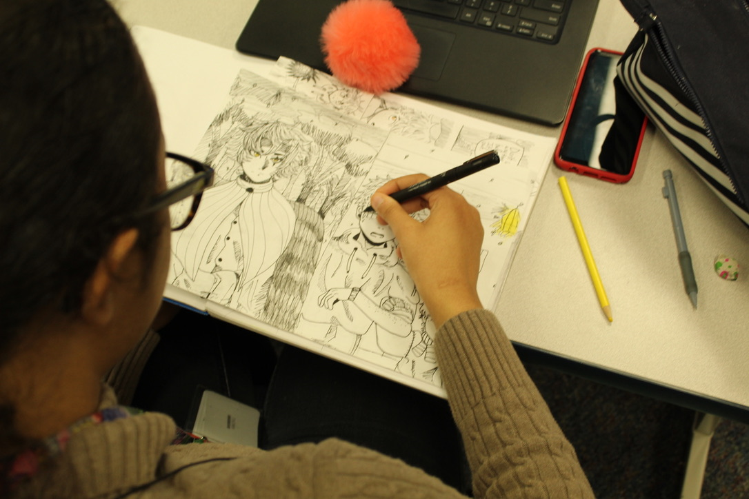 Kinser works on her most recent drawing.