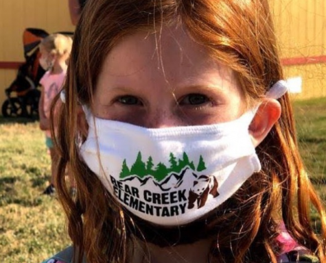 Student wears mask while entering school.  Photo Credits to Lewis-Palmer School District