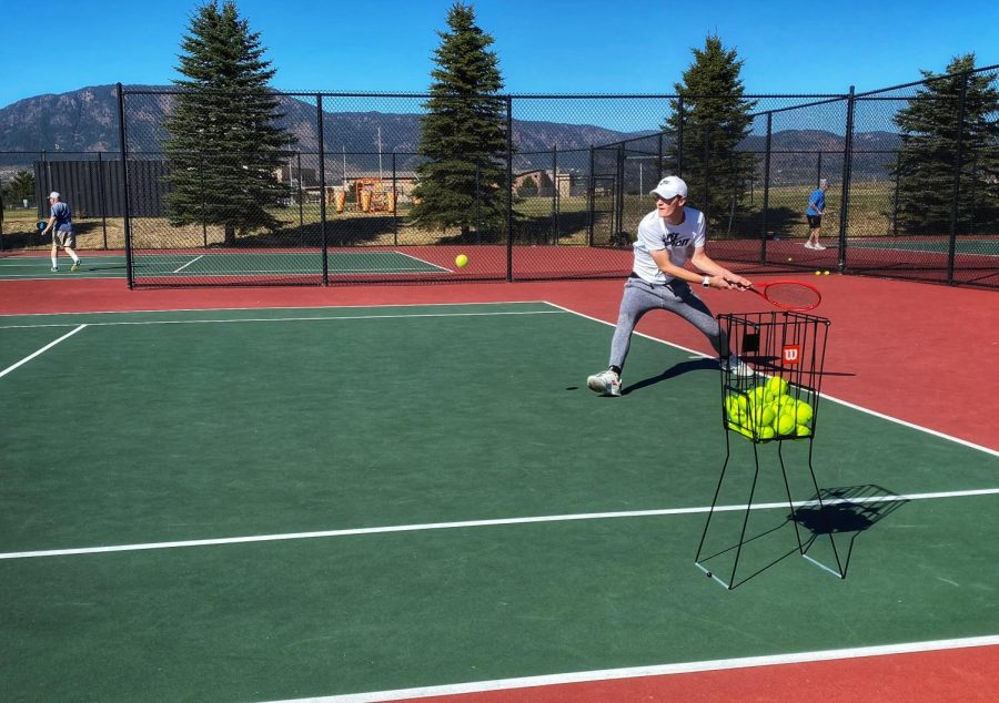 """Brennan returns a serve in a practice match with his mother. """"'Be aggressive' That's probably the best advice she's [his mother] given me,"""" Brennan said. """"Now I am definitely a very aggressive tennis player."""""""