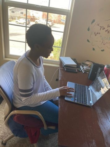 "Shaina Gichuki 9 works on an online assignment from home. ""Flex Fridays should just be left as office hours if students have questions. So I could sign in for maybe ten minutes for attendance and any explanations teachers want to give me, and then I can leave when necessary."""