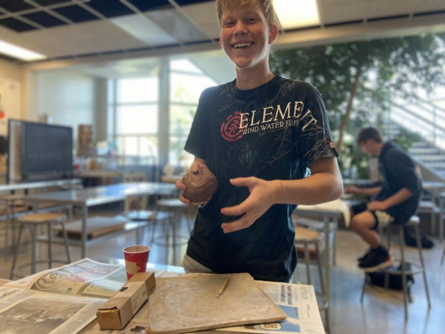 Ethan Hans in ceramics class, makes a clay statue that reminds him of his grandpa's life lessons.