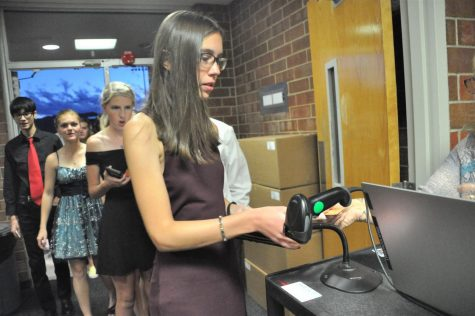 """Students line up to scan their homecoming tickets before the dance starts.""""We didnt have anything last year and a lot of kids that bought tickets were sophomores, who didnt get to have any high school experiences last year,"""" Carrie Coates SS said. """"Lifes gotten a little bit back to normal and they wanted to be part of that."""""""